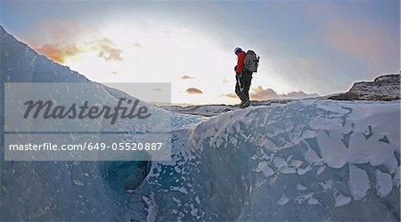 Man walking on glacier