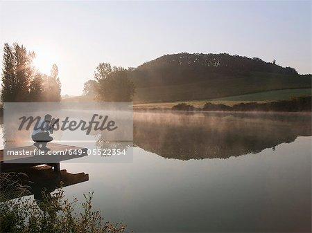 Man taking pictures of lake