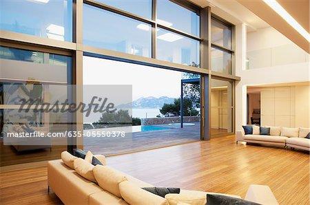 Sofas and sliding doors in open modern house