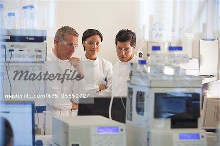 Scientists using equipment in lab