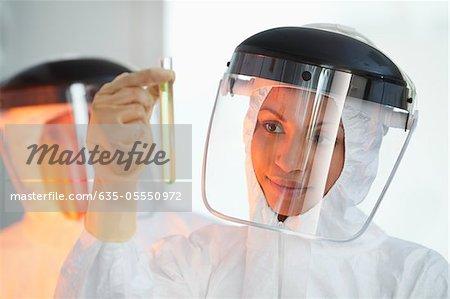 Scientist examining test tube in lab