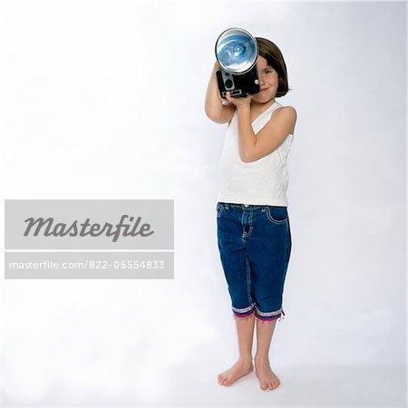 Girl Holding Vintage caméra avec Flash