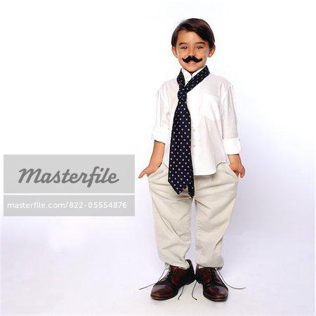 Boy Wearing Fake Moustache and Oversized Man's Clothing