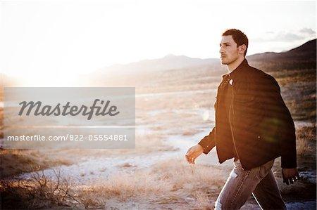 Man Walking in Desert Landscape
