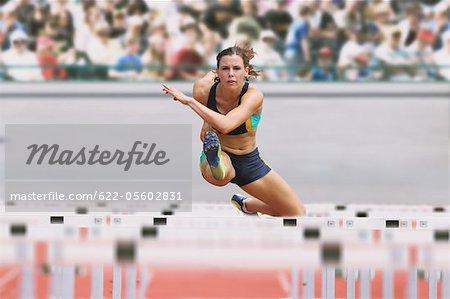 Female Runner Hurdling