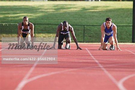 Runner On Race Track Preparing To Start