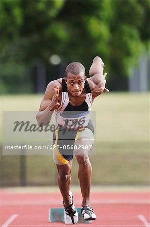 Athlete Sprinting From Starting Blocks