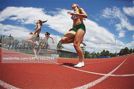 Female Runners on Racing Track