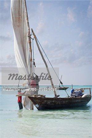Fishermen on Dhow Preparing to Set Sail, Zanzibar Island, Tanzania