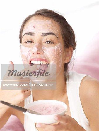 Woman tasting fruit face mask