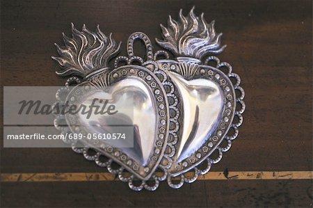 Ornate metal hearts
