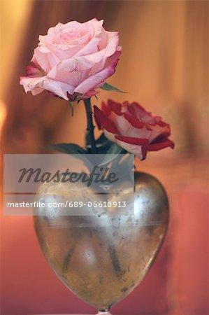 Roses in heart-shaped vase
