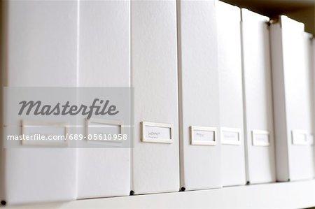 Row of white folders