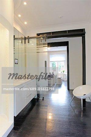 Modern bathroom with passage to open plan kitchen