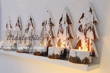 Christmas decoration with burning candles on ledge