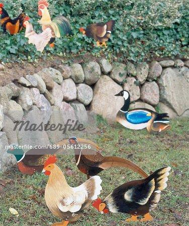 Birds figurines in garden