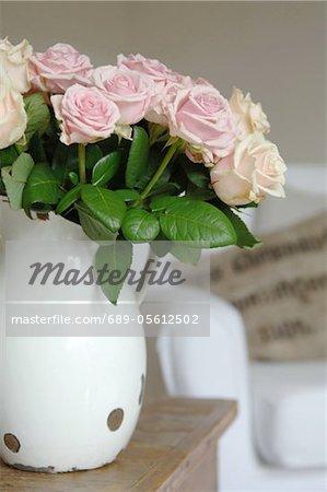 Bunch of roses in jug