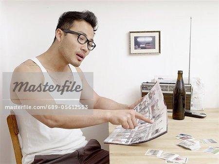 Man holding soccer collectors album