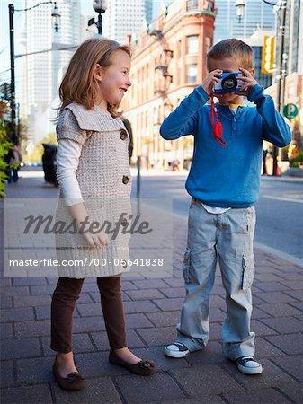 Two Children Taking Photographs, Front Street, Toronto, Ontario, Canada
