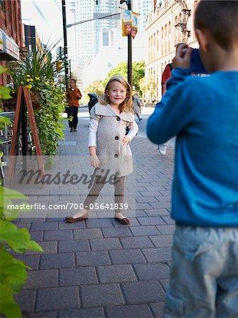 Boy Taking Photograph of Girl, Front Street, Toronto, Ontario, Canada