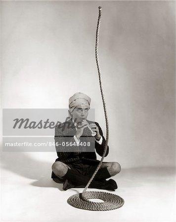 1960s MAN SNAKE CHARMER CHARACTER IN TURBAN PLAID JACKET SHORTS KNEE SOCKS