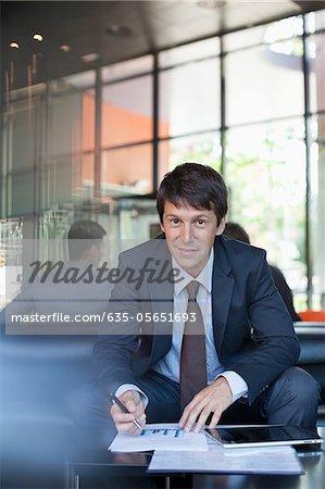 Businessman working in lobby