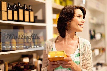 Woman examining box in store