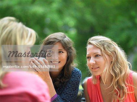 Women having coffee at sidewalk cafe