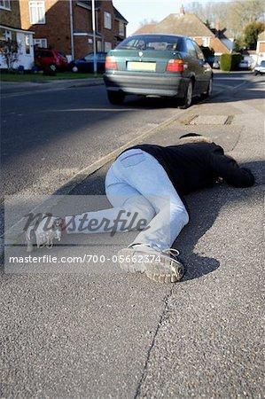 Teenage Girl Lying on Unconcious Pavement