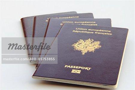stack of biometric passports on white background