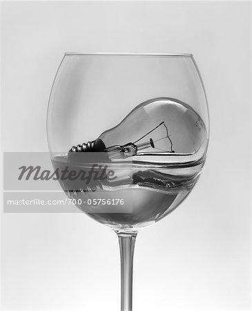 Light Bulb Soaking in Water in Wine Glass