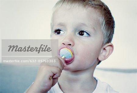 Toddler boy lollipop manger, portrait