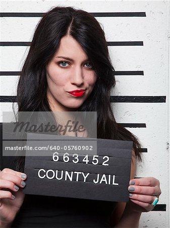 Studio mugshot of young woman