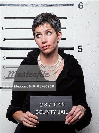 Studio mugshot of mature woman
