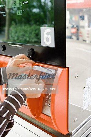 Paying at the gas pump, using credit card reader