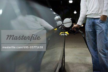 Driver refueling car
