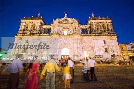 People dancing outside Leon Cathedral, Basilica de la Asuncion, Leon, Nicaragua, Central America