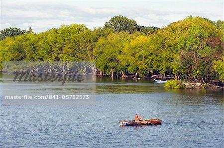 Man rowing a boat on Ometepe Island, Lake Nicaragua, Nicaragua, Central America