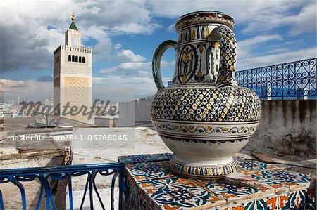 Minaret of the Great Mosque (Jamaa el Zitouna ) and local pottery, Medina, UNESCO World Heritage Site, Tunis, Tunisia, North Africa, Africa