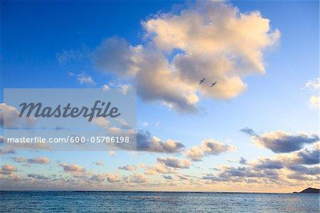 Wolken über dem indischen Ozean, Anse Source d ' Argent, La Digue, Seychellen