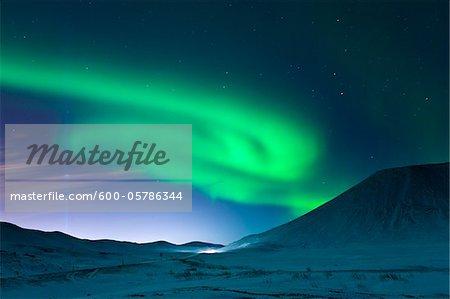 Aurora Borealis and Imagine Peace Tower, Videy, Kollafjordur Bay, Iceland