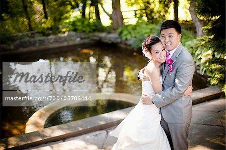 Bride and Groom near Pond