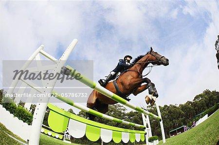 Reiten Reiter springen Hürde