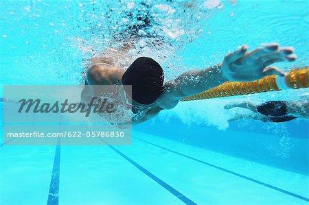 Man Swimming in Pool, Underwater