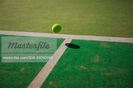 Tennis ball bouncing on court