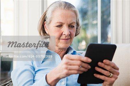 Senior woman reading electronic book