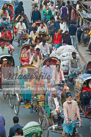 Busy rickshaw traffic on a street crossing in Dhaka, Bangladesh, Asia