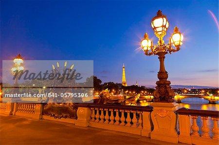 Eiffel Tower as seen from the Pont Alexandre III (Alexander III Bridge) at night, Paris, France, Europe