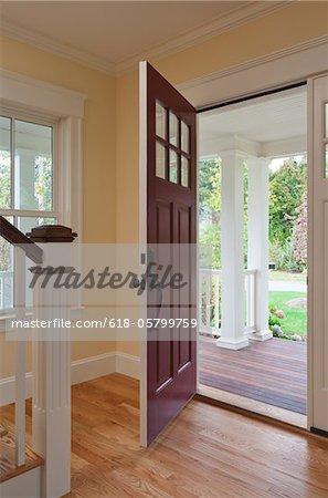 Open front door of home interior