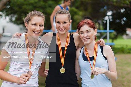 Women wearing medals in park